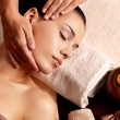 Stock Photo: Womhaving massage in spsalon
