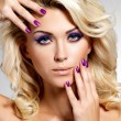 Beautiful woman with beauty purple manicure and makeup of eyes. — Foto de stock #16908123