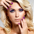 Stockfoto: Beautiful woman with beauty purple manicure and makeup of eyes.