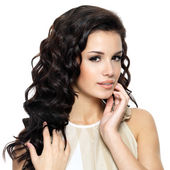 Beautiful young woman with beauty long curly hair. — Stock Photo