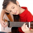 Smiling boy is playing the acoustic guitar - Stock Photo