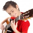 Smiling boy is playing on acoustic guitar — Stock Photo #18443603