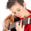 White boy is playing on acoustic guitar — Stock Photo #18443609