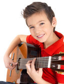 Smiling boy is playing on acoustic guitar — Stock Photo