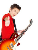 Portrait of young boy with a electric guitar — Stock Photo
