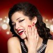 Stock Photo: Young pretty womwith red manicure and lips