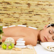 Stone massage for woman at  spa salon. — Stockfoto