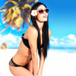 Happy woman in bikini on beach — Foto Stock