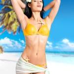 Woman with beautiful body in bikini at beach — Stock Photo #19123813