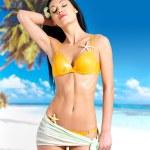 Woman with beautiful body in bikini at beach — Stock Photo #19123821