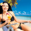 Happy woman on vacation enjoying at beach — Stock Photo #19123987