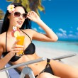Happy woman on vacation enjoying at beach — Stockfoto