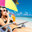 Happy woman on vacation enjoying at beach - Stock Photo