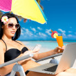 Woman on the beach with mobile phone — Stock Photo #19124151