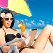 Happy woman on the beach with ipad - Stock Photo