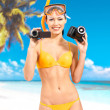 Royalty-Free Stock Photo: Woman with a photo and video camera on beach