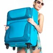 Casual woman holds the heavy travel suitcase — Stock Photo