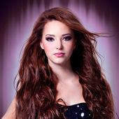 Beautiful woman with long hairs — Stock Photo