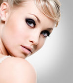 Beautiful woman with style eye makeup. — Stock Photo