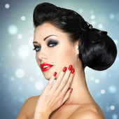 Fashion woman with red lips, nails and creative hairstyle — Stock Photo