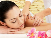Woman having massage of shoulder in spa salon — Stock Photo