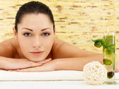 Smiling woman at beauty spa salon — Stock Photo
