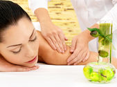 Woman having massage of body in spa salon — Stock Photo
