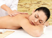 Woman on therapy massage of back in spa salon — Stock Photo
