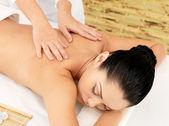 Woman having massage of body in spa salon — Stock Photo