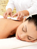 Woman having hot stone massage of body in spa salon — Stock Photo