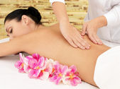 Woman on healthy massage of body in beauty salon — Stock Photo