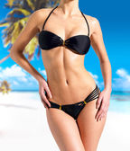 Beautiful Body of woman in bikini at beach — Stock Photo