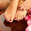Female feet at spa salon on pedicure procedure — Stockfoto