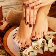 Female feet at spa salon on pedicure procedure — Foto de Stock