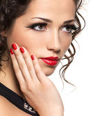 Beautiful fashion woman with red manicure and lips — Stock Photo