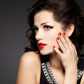 Fashion model with red nails — Stock Photo