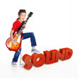 Boy plays on electric guitar with 3d text - Stock Photo