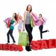 Group of happy women with shopping bags — Stockfoto