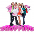 Group of happy women with shopping bags — Stok fotoğraf