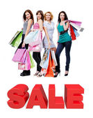 Group of happy women with shopping bags — Stock Photo