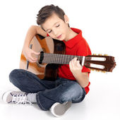 Smiling boy is playing the acoustic guitar — Foto Stock