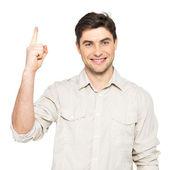 Jeune homme heureux avec le signe de la bonne idée — Photo