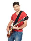 Guitarist man plays on the electric guitar — Stock Photo