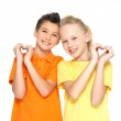 Happy children with a sign of heart shape — Stock Photo #21858985
