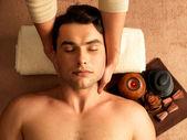 Man having neck massage in the spa salon — Stock Photo