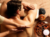 Man having massage in the spa salon — Stock Photo