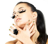 Woman with golden nails and style makeup — Stock Photo