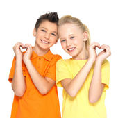 Happy children with a sign of heart shape — Stock Photo