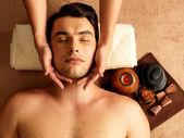 Man having head massage in the spa salon — Stock Photo