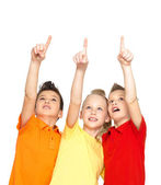Portrait of the happy children point up by finger - isolated on — Photo